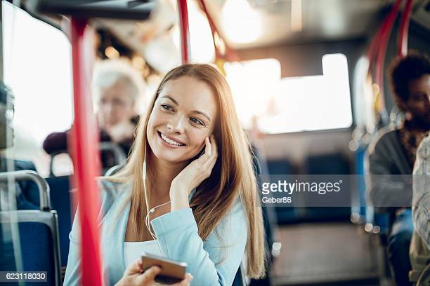 businesswoman using a phone - commuter stock pictures, royalty-free photos & images