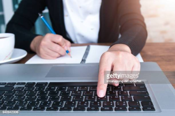 Businesswoman using a working laptop
