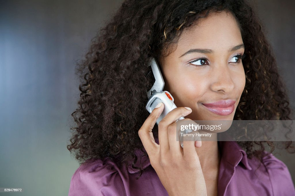 Businesswoman using cell phone : Stock Photo