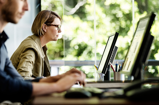 Businesswoman using computer in office 555250289