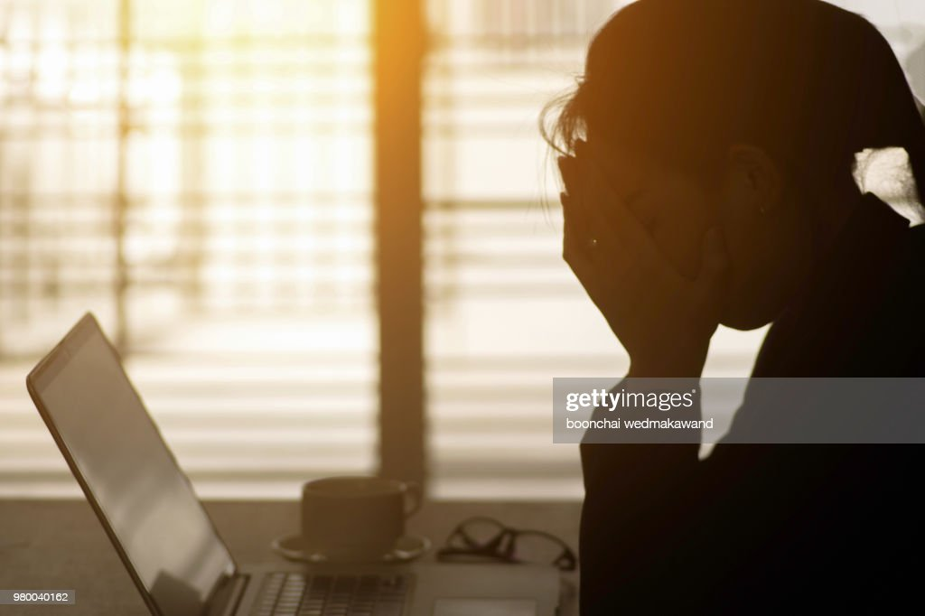 Businesswoman using computer in the office. Stress in the office : Stockfoto