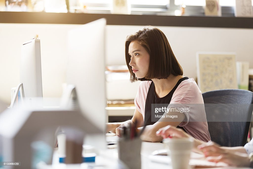 Businesswoman using computer : Stock Photo