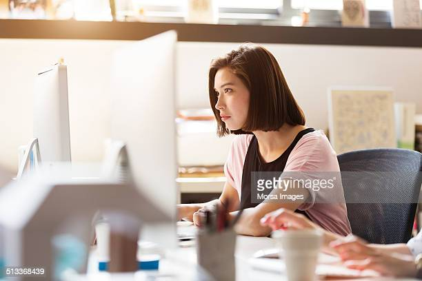 businesswoman using computer - concentration stock pictures, royalty-free photos & images