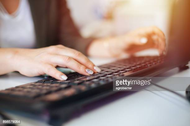 businesswoman using desktop pc at office - computer keyboard stock pictures, royalty-free photos & images