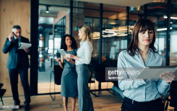 businesswoman using digital device - executive director stock pictures, royalty-free photos & images