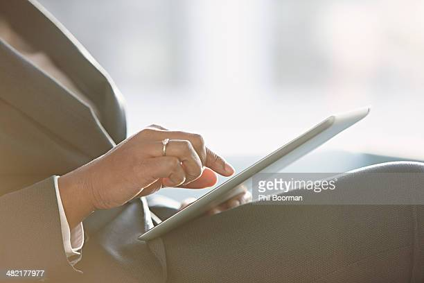 Businesswoman using digital tablet, close up