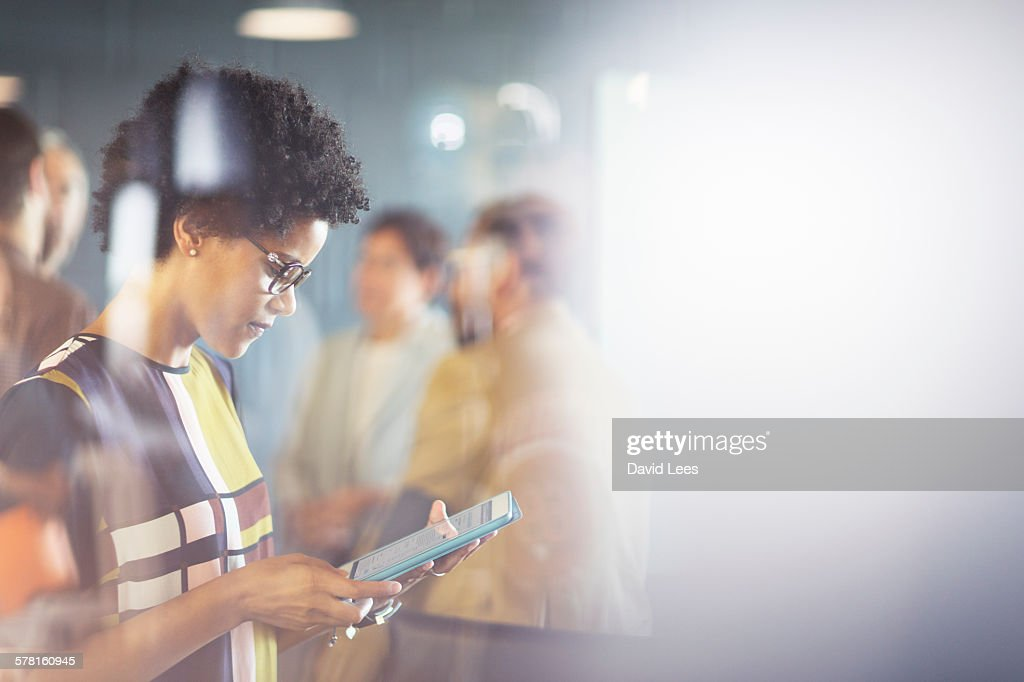 Businesswoman using digital tablet in meeting : Stock Photo