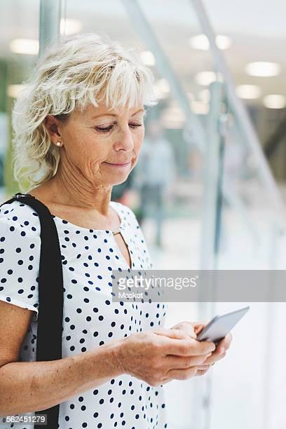 Businesswoman using digital tablet in modern office