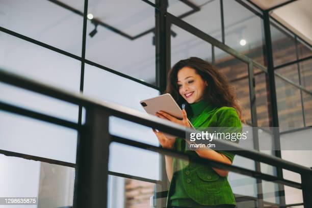 businesswoman using digital tablet in the office - green colour stock pictures, royalty-free photos & images