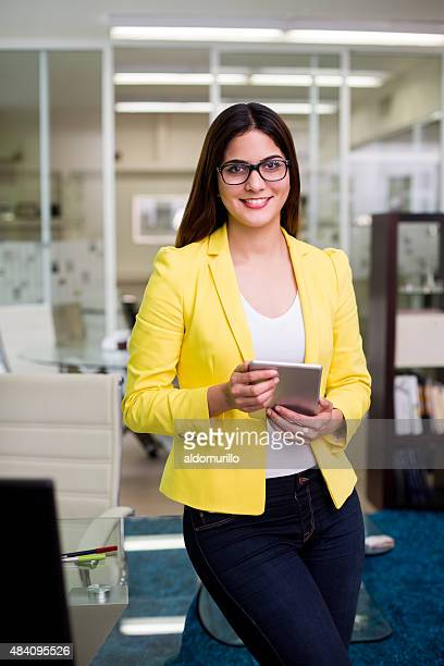 businesswoman using digital tablet - mexican business women stock photos and pictures