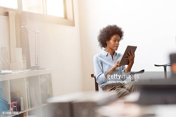 businesswoman using digital tablet - focus on background stock pictures, royalty-free photos & images