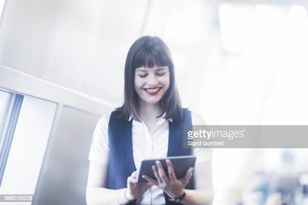 businesswoman using digital tablet - sigrid gombert stockfoto's en -beelden