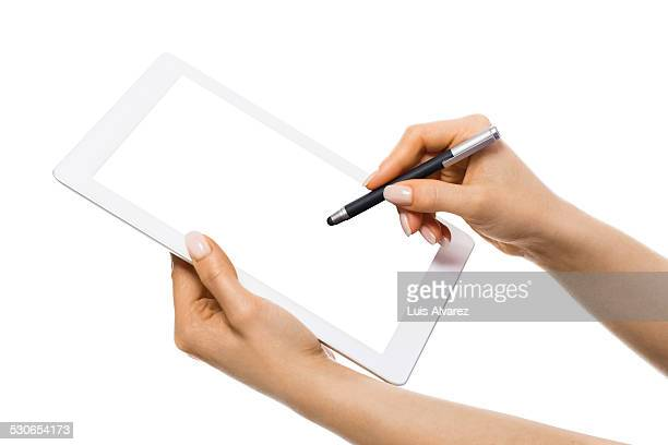 Businesswoman using digital tablet with stylus