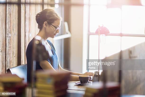 Businesswoman using keyboard in office