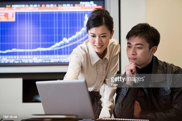 Businesswoman Using Lap Top in Meeting