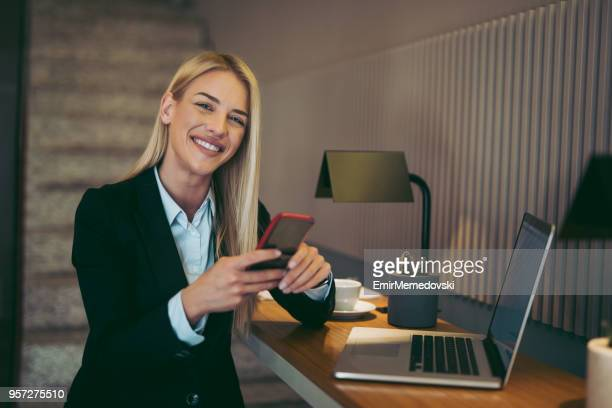 Businesswoman using laptop and smart phone