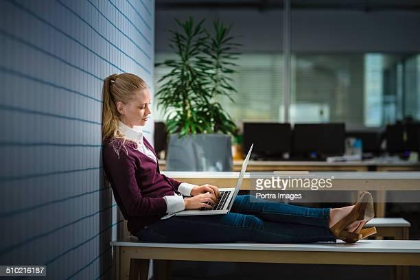Businesswoman using laptop at late night