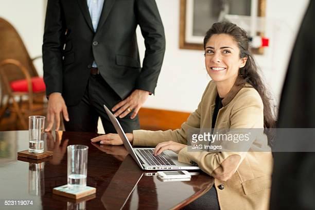 Businesswoman using laptop at meeting, Sao Paulo, Brazil