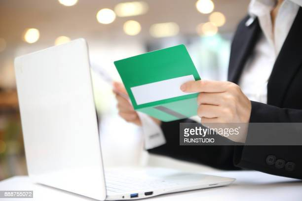 Businesswoman using laptop for online banking