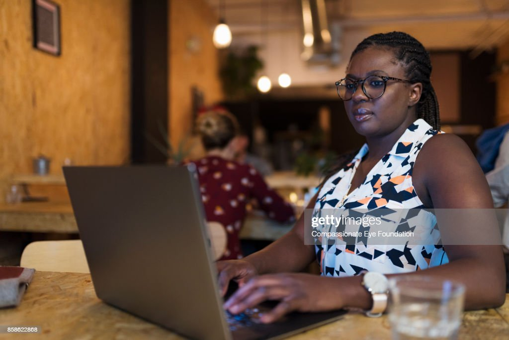 Businesswoman using laptop in cafe : Stock-Foto
