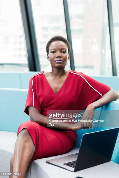 businesswoman using laptop in co-working space - vanguardians stock pictures, royalty-free photos & images