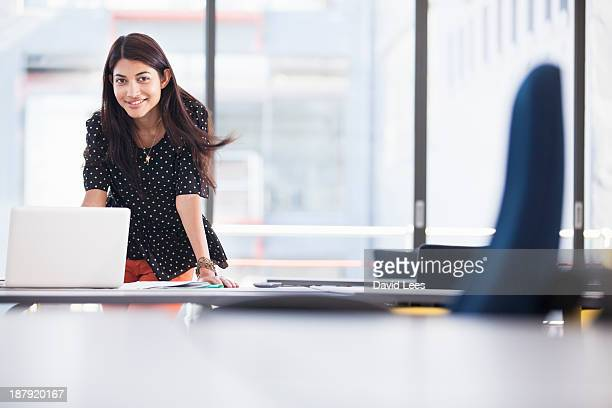 businesswoman using laptop in modern office - indian subcontinent ethnicity stock pictures, royalty-free photos & images