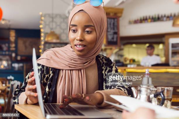 businesswoman using laptop in tea room - tea room stock pictures, royalty-free photos & images