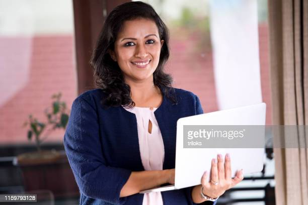 businesswoman using laptop - females stock pictures, royalty-free photos & images