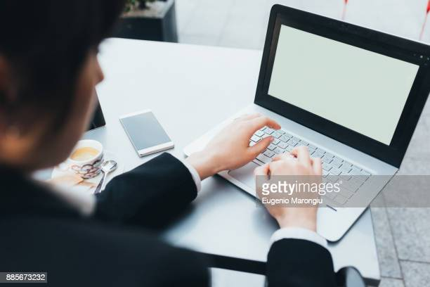 businesswoman using laptop - financial analyst stock photos and pictures