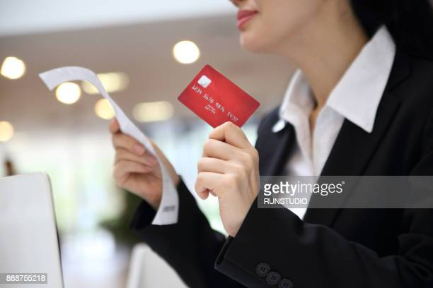 Businesswoman using laptop with credit card