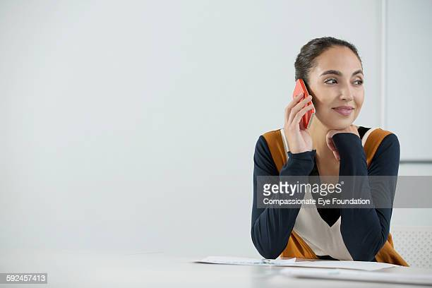 businesswoman using mobile phone in office - vanguardians stock pictures, royalty-free photos & images