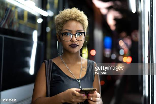 businesswoman using mobile with city on background - afro caribbean ethnicity stock pictures, royalty-free photos & images