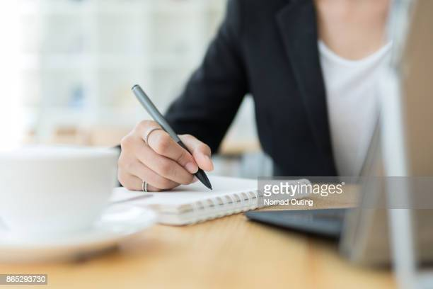 Businesswoman using pen for note to do list concept