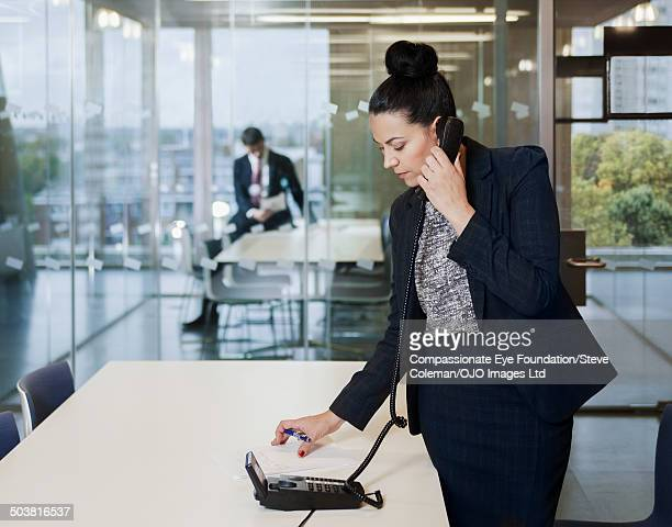businesswoman using phone in conference room - up do stock pictures, royalty-free photos & images