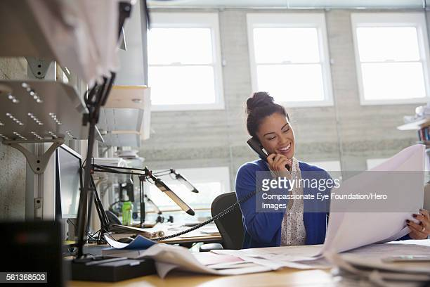 businesswoman using phone in modern office - photography stock pictures, royalty-free photos & images