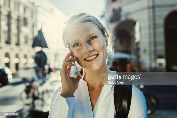 Businesswoman using phone.
