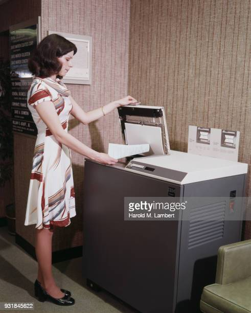 Businesswoman using photocopier