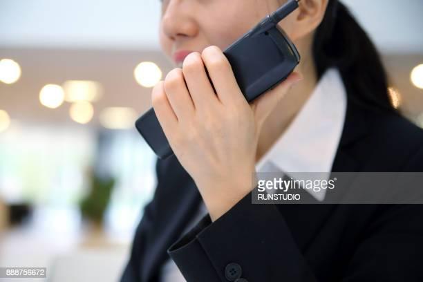 Businesswoman using radio