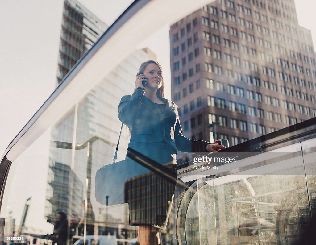 Businesswoman using smart device. : Stock Photo