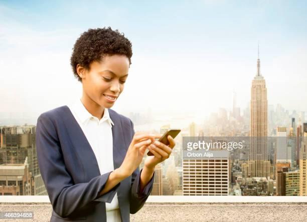 Businesswoman using smart phone in New York