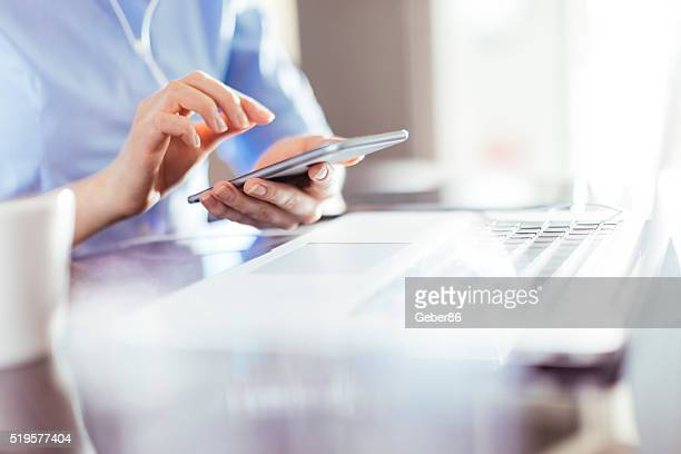 businesswoman using smart phone - computer keyboard stock pictures, royalty-free photos & images