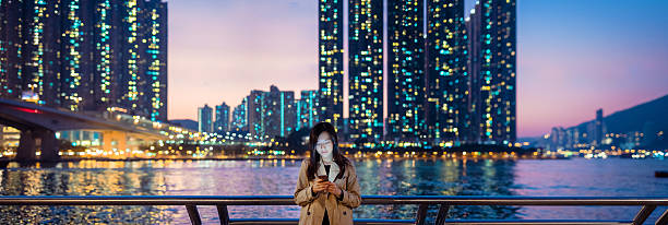 Businesswoman Using Smartphone In City Wall Art