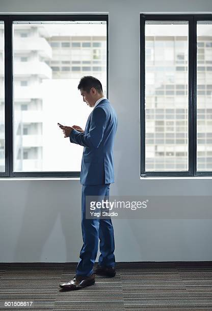 Businesswoman using Smartphone  in empty office
