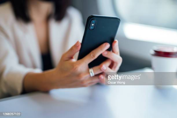 businesswoman using smartphone on commute - on the move stock pictures, royalty-free photos & images