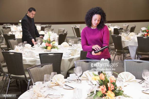 Businesswoman using tablet computer in dining room