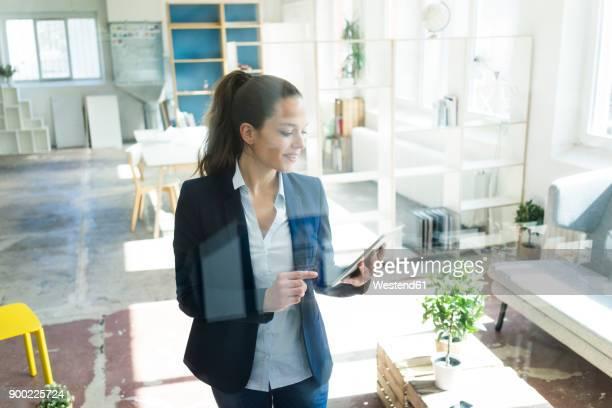 Businesswoman using tablet in a loft