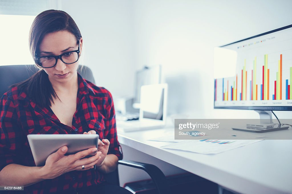 Businesswoman using tablet : Stock Photo