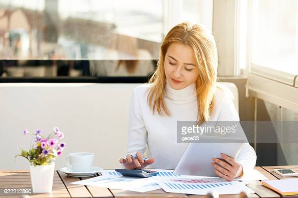 businesswoman using tablet - calculator stock photos and pictures