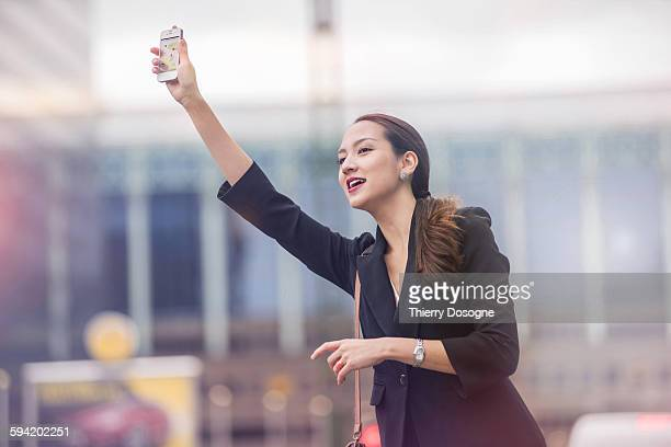 Businesswoman using taxi mobile app