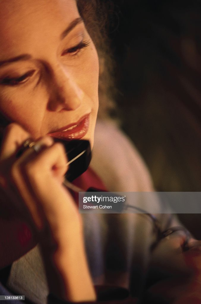 Businesswoman using the telephone : Stock Photo
